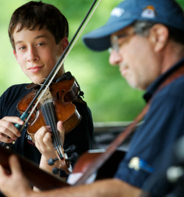 Max Silverstein, 15, of Bangor plays onstage with his father Jeff at the East Benton Fiddlers Convention July 29, 2012. (By Troy R. Bennett)