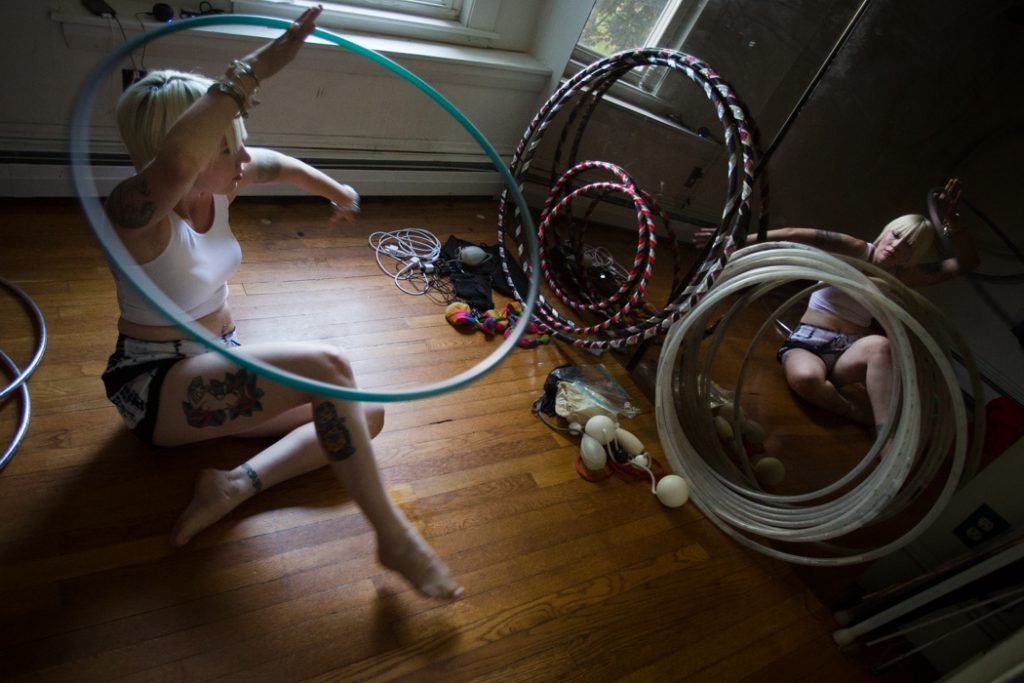 Alexis Powers spins a hoop while rehearsing in a special room at her house in Augusta. Powers regularly performs with lighted and flaming hoops at Portland's First Friday Art Walk. (Photo by Troy R. Bennett)
