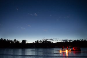 Mars and Venus rise in the night sky above the frozen surface of Horne Pond in Limington on Friday night as a group of ice fishermen gather around their campfire. Like me, the fishermen spent the night on the ice. (Photo by Troy R. Bennett)